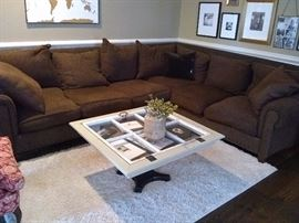 Brown Microfiber sectional with custom design window frame coffee table