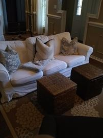 Small sofa, area rug, wicker baskets
