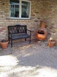 Vintage wooden outside bench with Blanchard's and outside fireplace