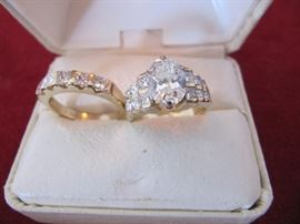 14k wedding set size 6 1/2 - appraised   Center diamond is 1 1/2 carat, si2, h   Side stones - 1.54 carat, si2, I/h