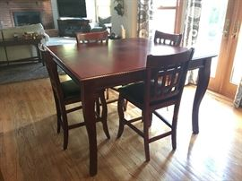 This tall table comes with 6 chairs