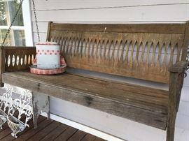 Old porch swing, bird feeder
