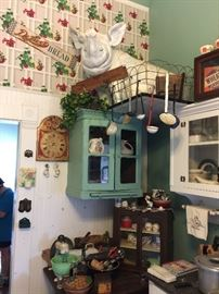 Kitchen full of authentic decor, appliances from late 1800's to 1940's