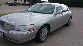 2003 Lincoln Town Car Cartier with 101,000 approximate miles.