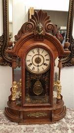 Oak New Haven mantle clock with figures...wants to run but needs work