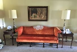Great orange velvet sofa with matching end tables and lamps.