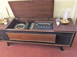 Nice stereo with radio in mid century modern cabinet.