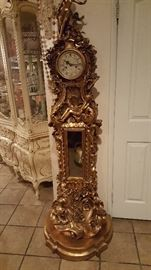Large clock that uses a key to whined the time. This is 1800s clock and In wood material  and in perfect condition