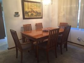 Dining table, 6 chairs, I additional leaf