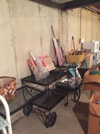 more wrought iron carts and small tables