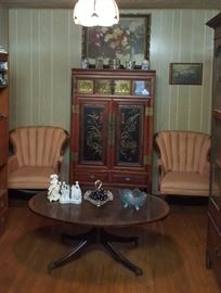 Beautiful Asian style cabinet, tufted armchairs and oval coffee table