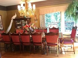 Antique dining table with twelve chairs