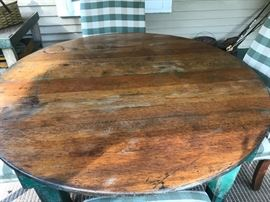 Beautiful patina finish on the vintage table. Located in the house.