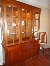 Ethan Allen Cherry china cabinet, matching table and chairs.