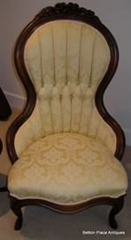 Victorian Ladies Arm Chair with a light lemon brocade fabric in beautiful condition, carved flowers at the top.