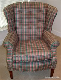 In a Pink and green plaid, excellent condition, very nice vintage wind back arm chair.
