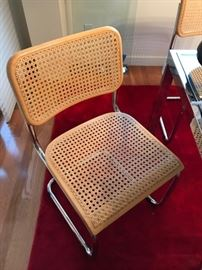 Cane and chrome dining chairs