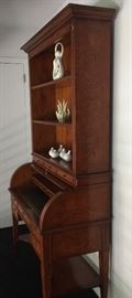 Antique Roll-top Desk w/Hutch. Desk has 5 Exterior Drawers & 4 Interior Drawers w/Leather Top.