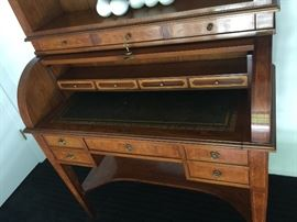 Roll-top Desk w/Hutch. Desk has 5 Exterior Drawers & 4 Interior Drawers w/Leather Top.