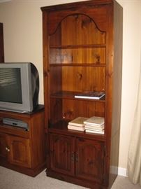 Tall solid wood bookshelf. There are two of these cabinets.