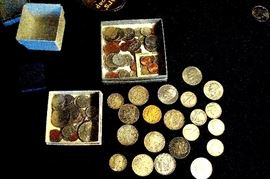 Some of the coins which includes a 1899 $20 gold piece and silver dollars & halves.