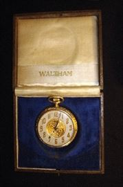 Waltham 14 kt. gold filled pocket watch in original case in good running condition.