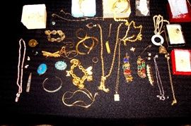 Some of the jewelry which includes 18 kt & 14 kt. items. Will have individual photos & descriptions later.