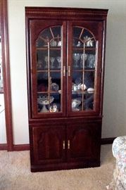 Solid cherry  china cabinet and contents. ( hummels, collectibles & etc.)