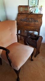 Close up view of living room items - upholstered chair, ladies writing desk, really nice magazine rack, old radio and 3 Charles Adams angels. - Great selection.