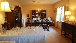 Broad view of living room and dining room - lots of great items for this sale!