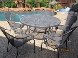 Round Iron Table with 5 chairs.