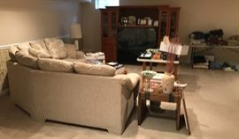 The sectional is priced at $100, as is the entertainment center.