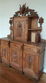HAND MADE AND CARVED HUNTSMAN CABINET. BREATHTAKING!