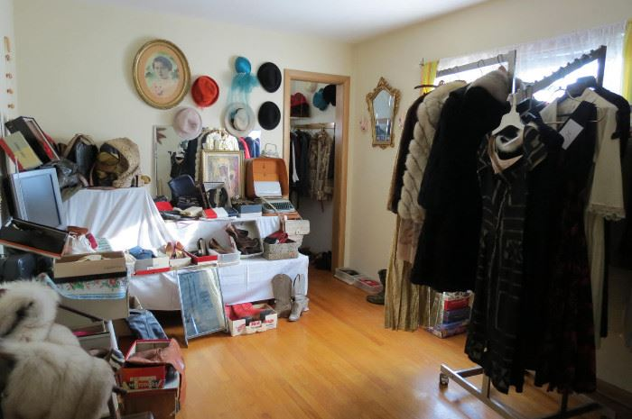 Roomful of vintage clothing..
