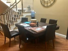 Dining table with 6 leather chairs