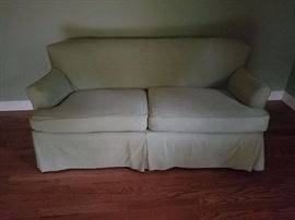 this sweet little sofa has a slip cover on it but looks great without it