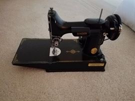 great featherweight Singer/  We have the case and the attachments