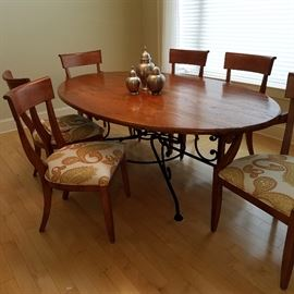 Arhaus Furniture Co. table with iron base, and 6 matching chairs