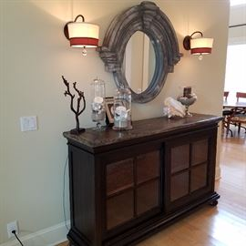 Hekman lighted credenza with sliding doors. Round 'porthole' mirror, Glass jars with shells, etc.