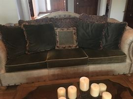 Nice sofa with nail head and leather trim/piping