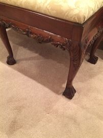 Close-up photo of the wonderful bench that is at the foot of the bed!