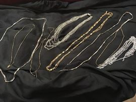 various collections of gold and silver chains