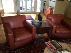 Leather chairs, side table, coffee table & beautiful rug.
