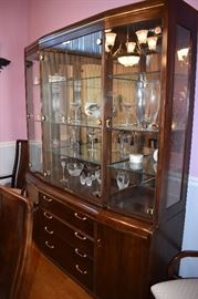 """Gorgeous Dining Suite in Immaculate Condition Features a """" Knockout"""" Dining Table that seats 12 with 12 Matching Chairs with Leaves and Pads, a Beautiful China Cabinet that is absolutely  made for Great Display and Storage, Lovely Mirror Backed Server for Silverware and Other Special Dining Accessories, plus a matching """"Romantic"""" (Throw Back to the 1920's) Glass Door Stemware Cabinet This One of a Kind Dining Room Set Suggests pure Dining Elegance from the moment you see it! A real prize for any Dining Experience!"""
