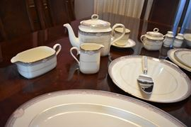 """Noritake Sheer Ivory Bone China Service for 12 Stanford Court Pattern ( 113pcs ) *** Plus *** Gorgeous Dining Suite in Immaculate Condition Features a """" Knockout"""" Dining Table that seats 12 with 12 Matching Chairs with Leaves and Pads, a Beautiful China Cabinet that is absolutely  made for Great Display and Storage, Lovely Mirror Backed Server for Silverware and Other Special Dining Accessories, plus a matching """"Romantic"""" (Throw Back to the 1920's) Glass Door Stemware Cabinet This One of a Kind Dining Room Set Suggests pure Dining Elegance from the moment you see it! A real prize for any Dining Experience!"""