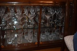 """Just a few of the 80+ pcs of Lenox """"Windswept"""" Crystal Stemware that includes: 11 Iced Tea Glasses, 15 Water Goblets, 15 Wine Goblets, 10 Fluted Champagne, 10 Martini, 14 Double Old Fashioned, 3 Single Light Candle Sticks, Pair of Salt & Pepper, Sugar & Creamer, plus Platter and Vases!"""