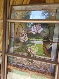 HANGING  ,Stained glassWindow  we have at least 10 windows of different types and sizes we also have stained glass lamps of different sizes .