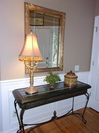 Beautiful Glass top entry/hall table with ornate design, Gold trimmed beveled edge mirror.