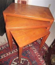 Teak nesting tables bearing the Illums Bolighus metal label