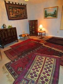 A collection of fine Afghan area carpets representing the various regions and styles of that land, Chinese rosewood cabinets with  brass fittings, old style brass fish locks and secret drawers and  a mid century teak lamp table from Denmark